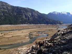 Skagit River flowing through drawn-down lake in March 2013.