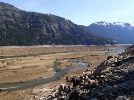Skagit River flowing through drawn-down lake in March 2013.
