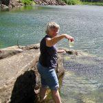 Dr. Matthews collecting an algae sample at Coal Lake.